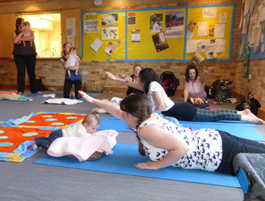 mums and babies practicing yoga