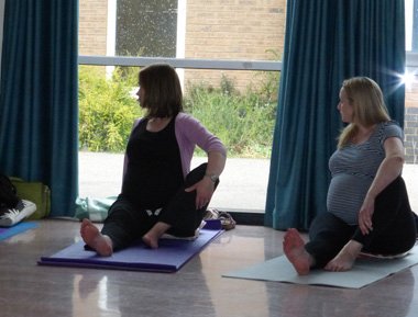 expectant mums practicing pregnancy yoga 1